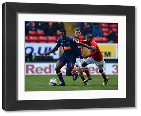 Blackpool's Isaiah Osbourne (Left) is held back by Charlton's Bradley Pritchard (Right)