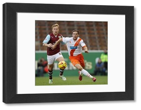 Burnley's Scott Arfield and Blackpool's Dan Gosling (right) battle for the ball