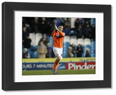 Blackpool's captain Barry Ferguson applauds the fans at the end of the game against Sheffield Wednesday