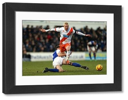 Ipswich Town's Cole Skuse and Blackpool's David Perkins compete for the ball