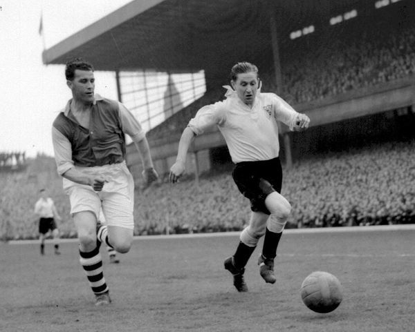 Blackpool and England footballer Stanley Mortenson (right) chases the ball with Arsenal's Leslie Compton in pursuit, during their 1949 Easter Bank Holiday match at Highbury stadium, in north London