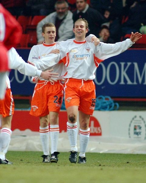 Blackpool's John Hills (number 15) celebrates scoring his team's opening goal against Charlton Athletic