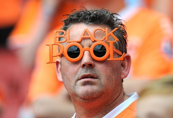 A Blackpool fan in the stands before the match