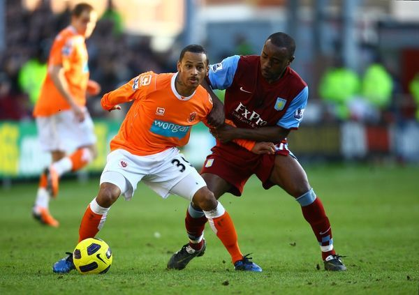 Blackpool's Dudley Campbell (left) and Aston Villa's Nigel Reo-Coker battle for the ball