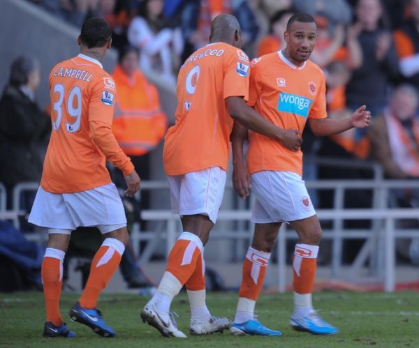Blackpool's Elliot Grandin is congratulated after scoring the opening goal