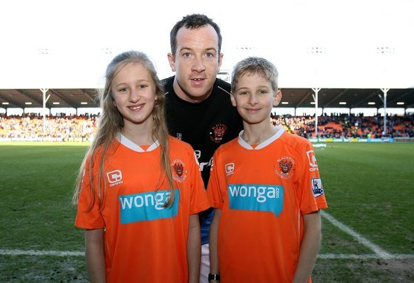 Mascots with Blackpool's Charlie Adam