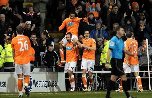 Blackpool's DJ Campbell (top centre) celebrates with his team mates after scoring his side's second goal of the game