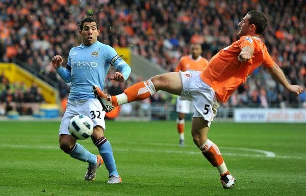 Blackpool's Neal Eardley (right) in action with Manchester City's Carlos Tevez