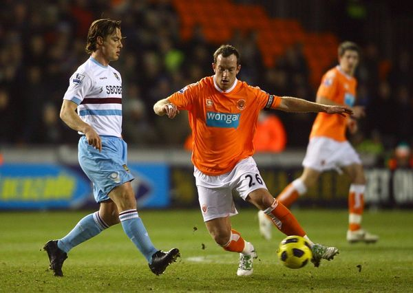 Blackpool's Charlie Adam (right) and West Ham United's Scott Parker battle for the ball