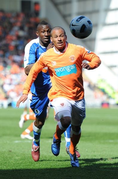 Wigan Athletic's Steve Gohouri (left) chases Blackpool's Dudley Campbell (right)