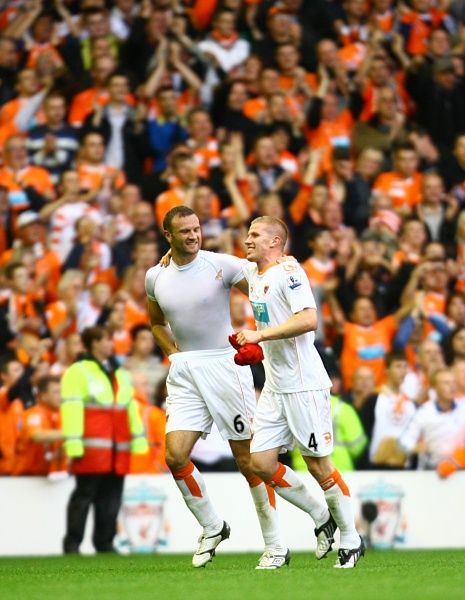 Blackpool's Ian Evatt (left) and Keith Southern (Right) celebrate after the final whistle