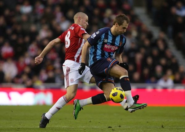 Stoke City's Andy Wilkinson (left) and Blackpool's Luke Varney (right) battle for the ball
