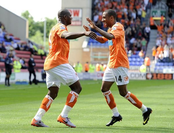Blackpool's Marlon Harewood (left) celebrates scoring his sides second goal of the game with team mate Eliot Grandin