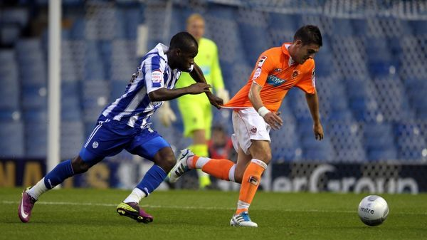 Sheffield Wednesday's Danny Uchechi and Blackpool's Rob Harris (right) battle for the ball