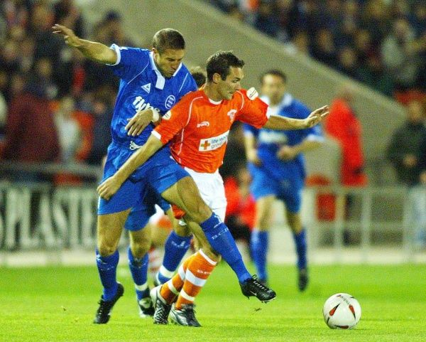 Blackpool's Scott Taylor (right) holds off Birmingham City's Matthew Upson from the ball