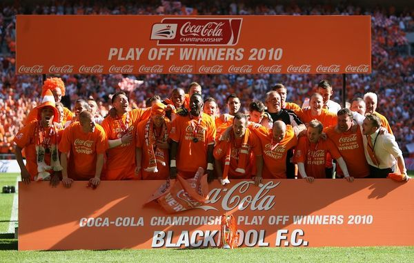 The Blackpool team celebrate their promotion