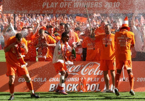 The Blackpool team celebrate after the final whistle