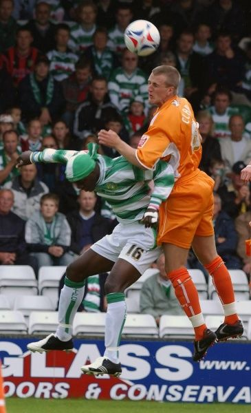 Blackpool's Peter Clarke (R) battles with Yeovil's Efetobore Sodje