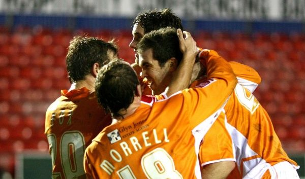 Blackpool's Ben Burgess celebrates scoring his side's fourth goal