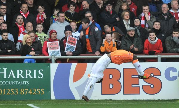Blackpool's Lomana LuaLua celebrates scoring his sides opening goal during the FA Cup, Third Round match at Highbury Stadium, Fleetwood