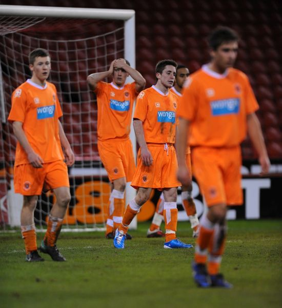 The Blackpool players look dejected after Sheffield United's Jordan Slew scores his sides second goal of the game in extra time