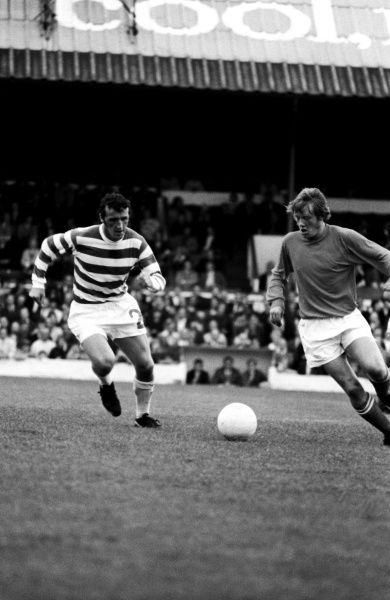 Blackpool's Alan Ainscow (r) takes on Celtic's Danny McGrain (l)