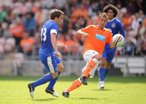 Blackpool's Angel Martinez and Everton's Seamus Coleman battle for the ball