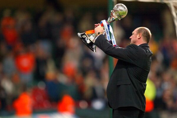 Blackpool manager Steve McMahon lifts the LDV Vans Trophy high