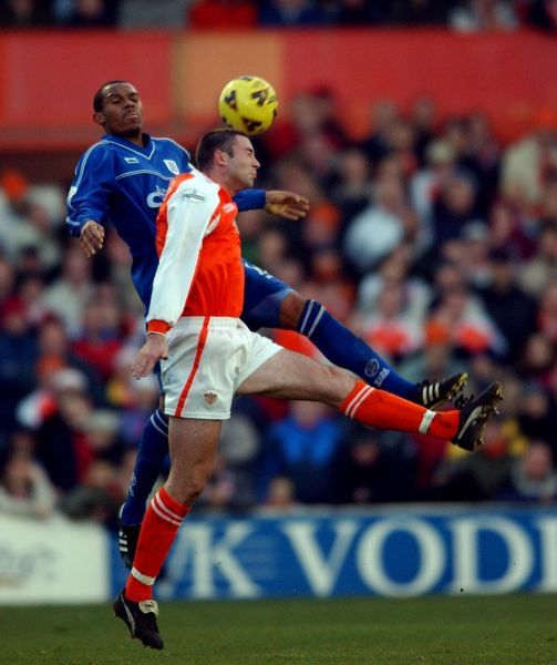 Cardiff City's Daniel Gabbidon loses out in the air to Blackpool's John Murphy