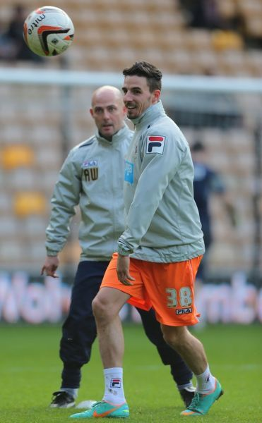 Blackpool's new signing Matt Derbyshire warms up before the npower Football League Championship match at Molineux, Wolverhampton