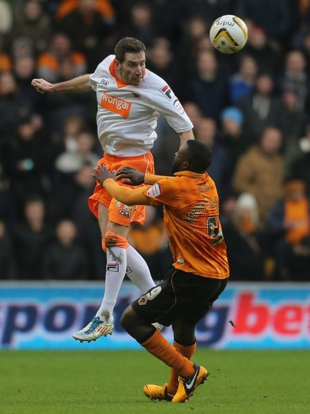 Blackpool's Kirk Broadfoot wins header beating beating Wolverhampton Wanderers' Sylvan Ebanks-Blake (right) during the npower Football League Championship match at Molineux, Wolverhampton