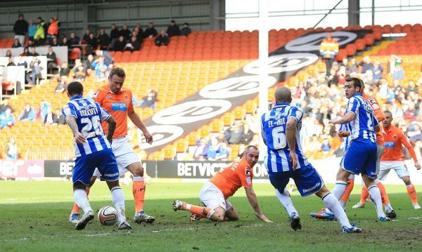 Blackpool's Ian Evatt scores the first goal during the npower Football League Championship match at Bloomfield Road, Blackpool