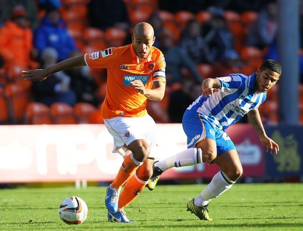 Blackpool's Alex Bapstise (left) and Brighton & Hove Albion's Liam Bridcutt (right) in action