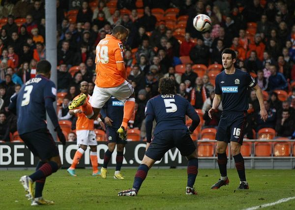 Blackpool's Wes Thomas scores his sides opening goal during the npower Football League Championship match at Bloomfield Road, Blackpool