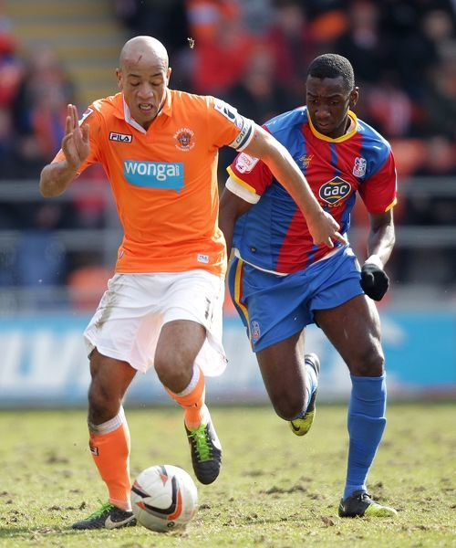 Blackpool's Alex Baptiste and Crystal Palace's Yannick Bolasie