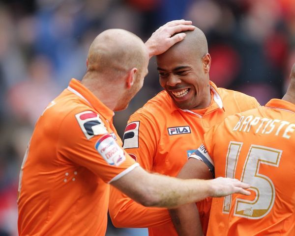 Blackpool's Ludovic Sylvestre celebrates scoring the only goal of the game against Burnley with team mate Stephen Crainey