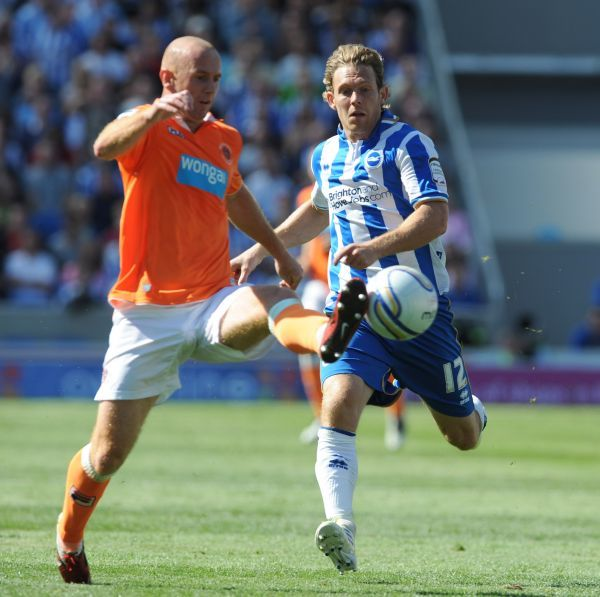 Brighton and Hove Albion's Craig Mackail-Smith and Blackpool's Gordon Greer