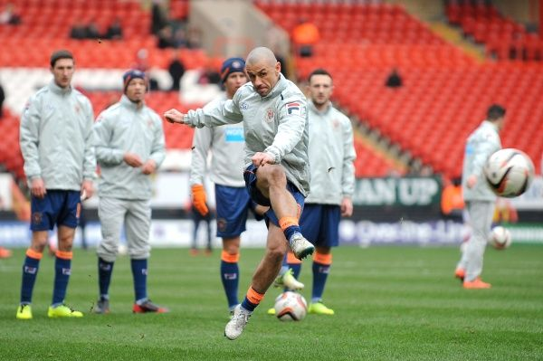 Blackpool's Kevin Phillips (centre) warms up with team-mates before the game