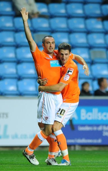 Blackpool's Gary Taylor-Fletcher (left) is congratulated by his team mate Craig Cathcart after he scores the opening goal of the game