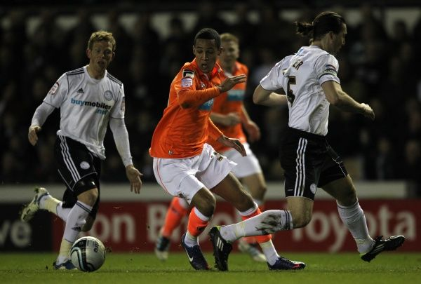 Derby County's Shaun Baker and Thomas Ince battle for the ball