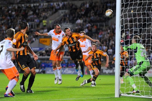 Blackpool's Gary Taylor-Fletcher has a headed attempt on goal