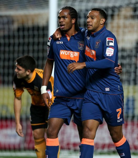 Blackpool's Matthew Phillips celebrates his goal with Nathan Delfounso (l)