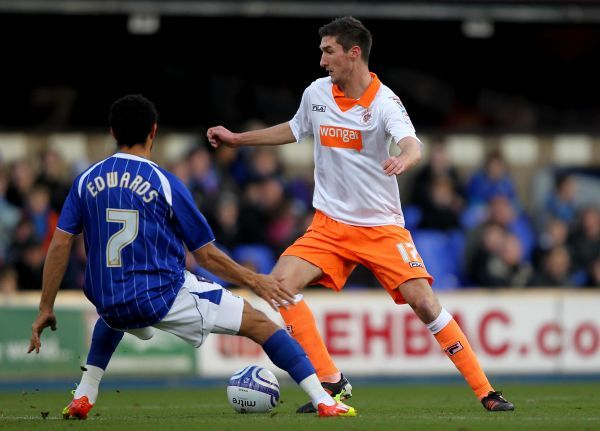 Blackpool's Chris Basham takes the ball past Ipswich Town's Carlos Edwards (left) during the npower Championship match at Portman Road, Ipswich