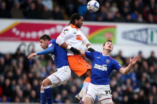 Ipswich Town's Tommy Smith (right) and Aaron Cresswell (left) are beaten to a ball in the air by Blackpool's Nathan Delfouneso