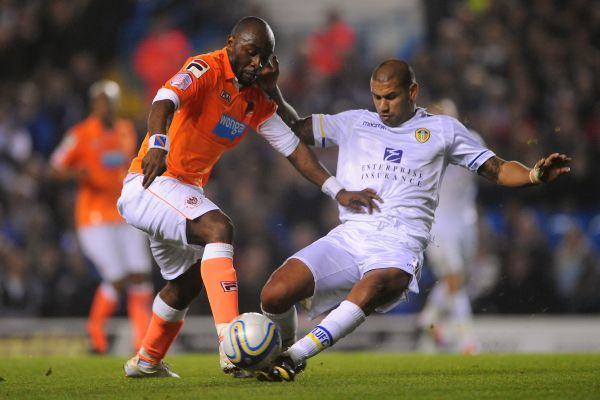 Leeds United's Patrick Kisnorbo (right) and Blackpool's Tresor Lomana LuaLua in action