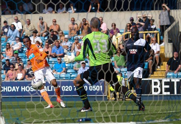Blackpool's Thomas Ince scores the opening goal of the game during the npower Championship match at The Den, London