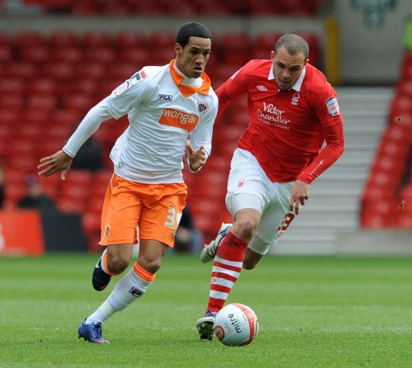 Nottingham Forest's Joel Lynch (right) and Blackpool's Thomas Ince (left) battle for the ball