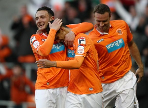 Blackpool's Tom Ince (centre) celebrates with team mates Neal Eardly and Ian Evatt, after his shot led to Birmingham's Curtis Davies scoring an own goal during the npower Football League Championship Playoff match at Bloomfield Road, Blackpool