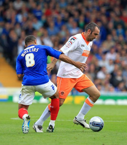 Blackpool's Gary Taylor-Fletcher gets away from Portsmouth's Hayden Mullins during the Npower Football League Championship match at Fratton Park, Portsmouth