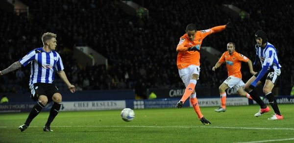 Blackpool's Tom Ince scores the opening goal of the game against Sheffield Wednesday